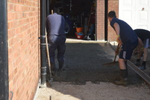 raking the concrete